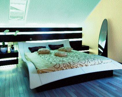 Спальня хозяев решена в минималистском стиле
